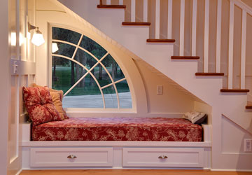 under-stairs daybed in a house